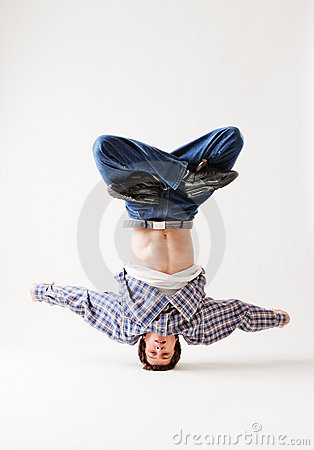 Hip-hop dancer balancing on his head