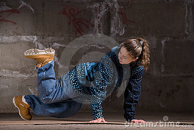 Hip hop dancer in modern style over brick wall