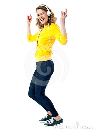 Hip hop woman with headphones enjoying music