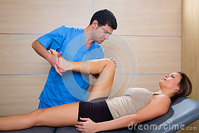 Hip mobilization therapy by therapist to beautiful woman