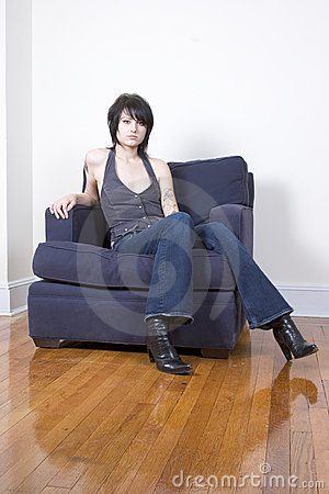 Free Hip Woman Sitting In A Chair Stock Photos - 583673