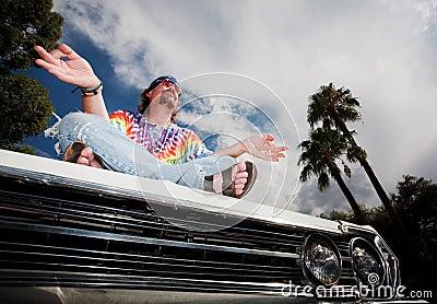 Hippie Meditating on Car Hood