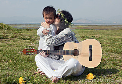 Hippie mother kisses son on cheek