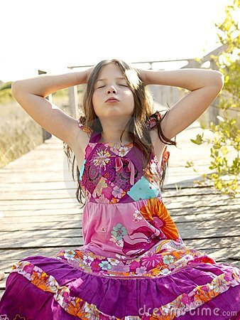 Hippy purple dress teen girl relaxed outdoors