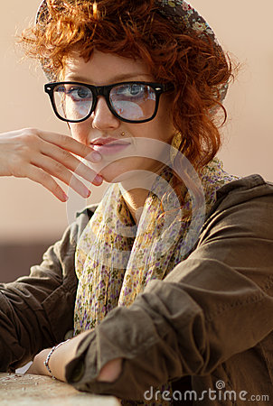 Hipster girl sitting at the table