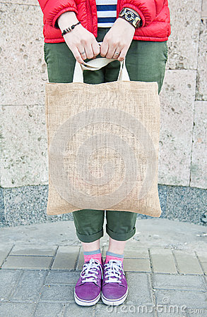 Free Hipster Woman Holding Empty Canvas Bag Outdoor. Template Mock Up Stock Image - 93551761