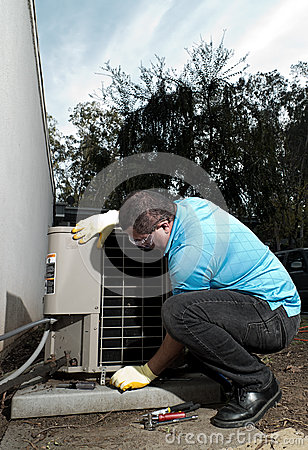 Hispanic air conditioning system repair man