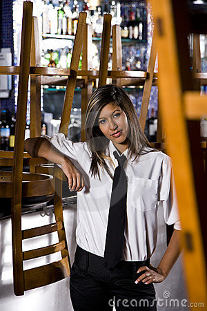 Hispanic bartender at closed bar