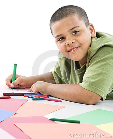 Hispanic boy coloring.