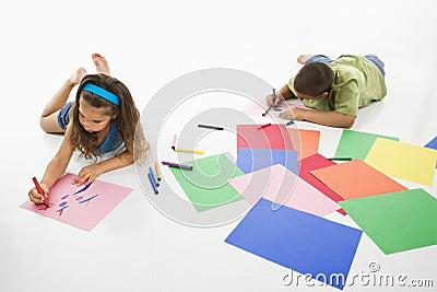 Hispanic boy and girl coloring.
