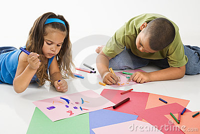 Hispanic boy and girl coloring.