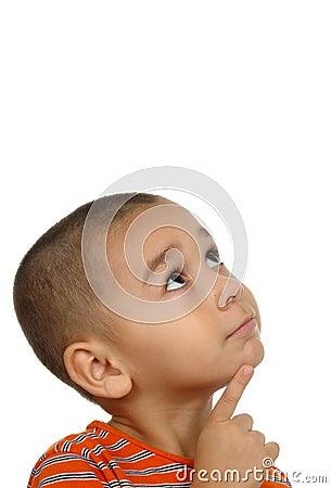 Hispanic boy looking up in wonder