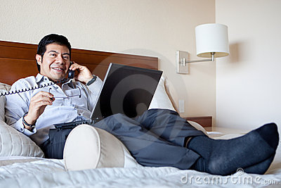 Hispanic businessman in his hotel room