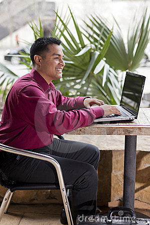Hispanic Businessman - Telecommuting from Cafe