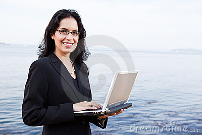 Hispanic businesswoman with laptop