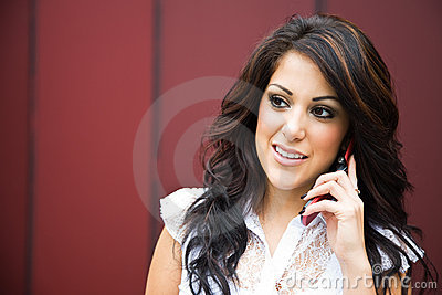 Hispanic businesswoman on the phone