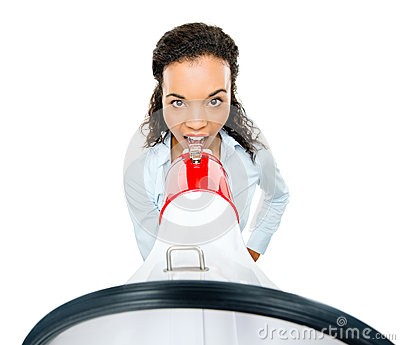 Hispanic businesswoman shouting megaphone loudspeker white