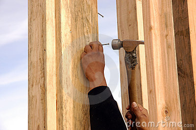 Hispanic carpenter pounding
