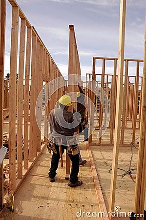 Free Hispanic Carpenters Setting A Wall Royalty Free Stock Image - 3899236