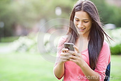 Hispanic college student texting