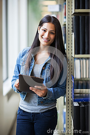 Free Hispanic College Student Using Tablet PC Stock Photo - 26279820