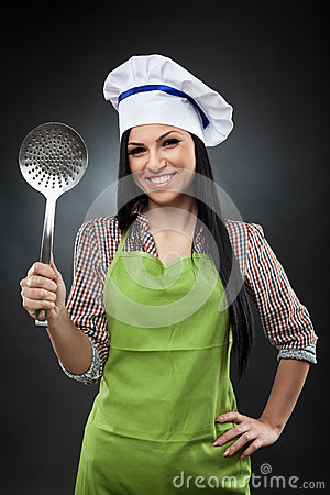 Hispanic cook with skimmer