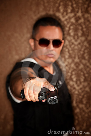 Hispanic Cop Pointing Gun