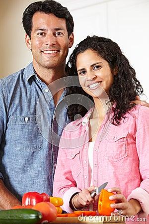 Hispanic couple cooking