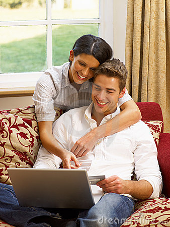 Hispanic couple at home online shopping