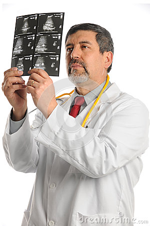 Hispanic Doctor Examining Ultrasound Film