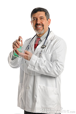 Hispanic Doctor Using Hand Sanitizer