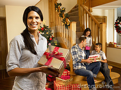 Hispanic family at christmas exchanging gifts