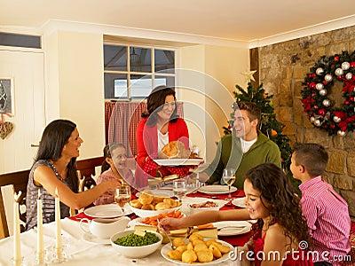 Hispanic family at home serving christmas dinner