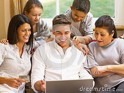 Hispanic family at home shopping online