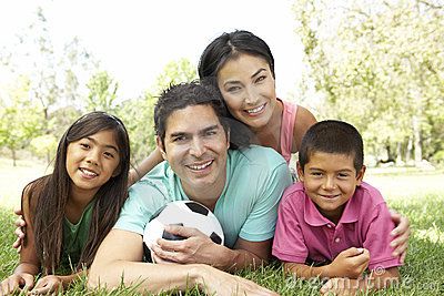 Hispanic Family In Park With Soccer Ball