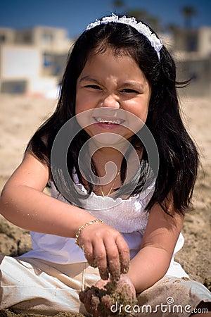 Free Hispanic Girl Building A Sand Stock Photos - 5471313
