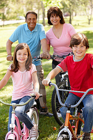 Hispanic grandparents with grandchildren on bikes