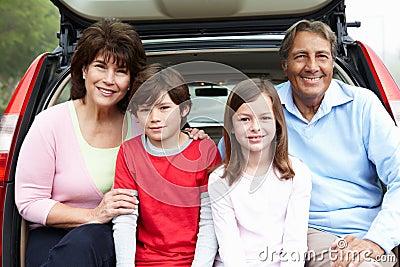 Hispanic grandparents and grandchildren outdoors