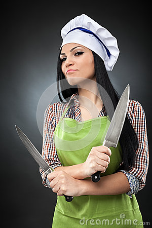 Hispanic lady chef with knives