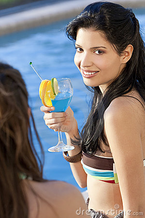 Hispanic Latina Woman Drinking Cocktail By Pool