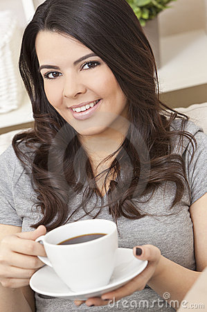 Hispanic Latina Woman Drinking Tea or Coffee