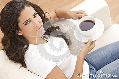 Hispanic Latina Woman Drinking Tea or Coffee