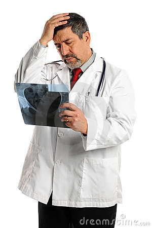 Hispanic Male Doctor Looking at X-ray