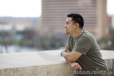 Hispanic Man - Looking out from balcony