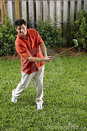 Hispanic man practicing his golf swing
