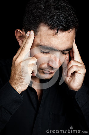 Hispanic man suffering a strong headache