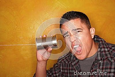 Hispanic man with tin can telephone