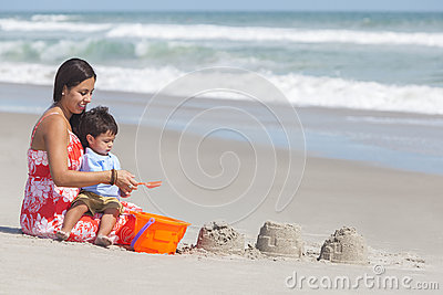 Hispanic Mother and Child Boy Son Playing At Beach