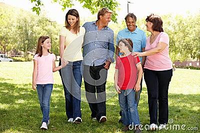 Hispanic Mulit generation family walking in park