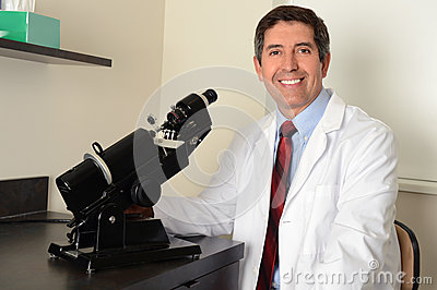 Hispanic Researcher Using Microscope